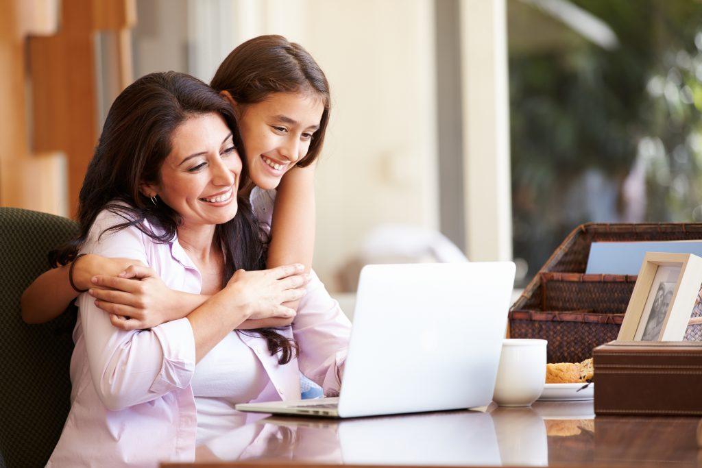 Mom and her teenage daughter looking at returnship programs